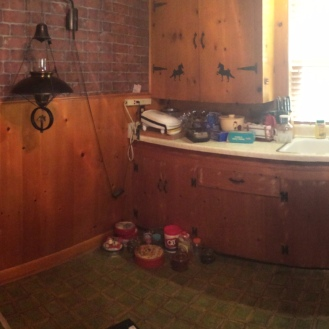 Panoramic of the Kitchen standing in the entry to the dining room