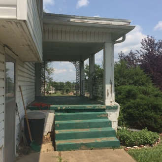 The steps to the porch are concrete