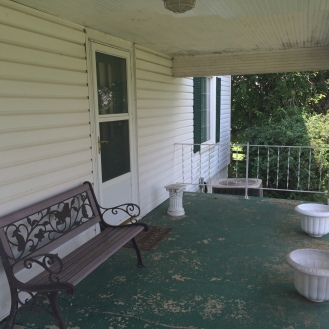 The front porch needs a lot of work. It was covered in peeling green paint